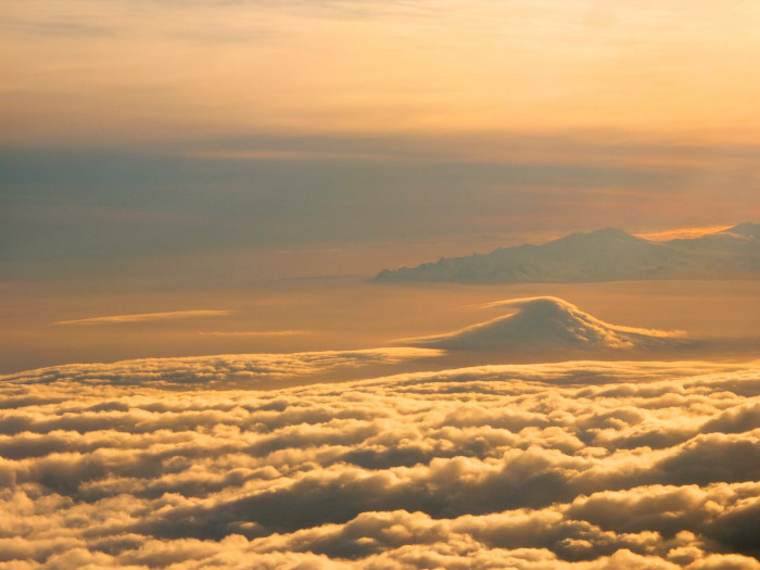 13) The sun glinting off Cleveland Volcano during a flight to Unalaska.