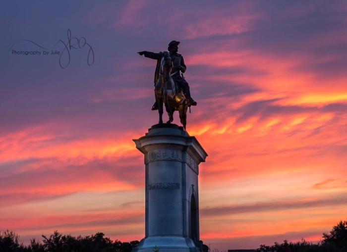 11) The statue of Sam Houston at the Houston Zoo stands out against the cotton candy sky in the background.