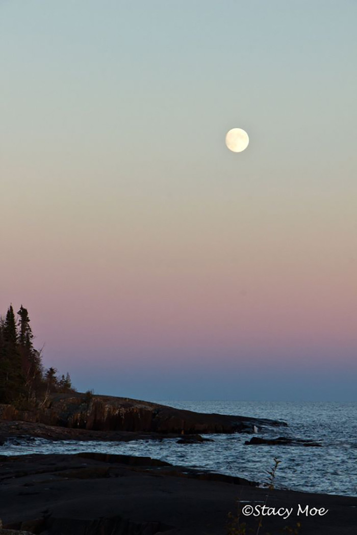 AND she beautifully photographed the moon over Artist's Point in Grand Marais.