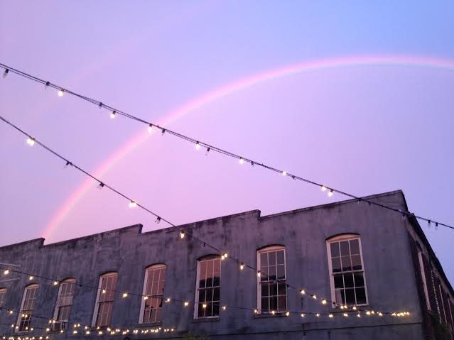 1. A beautiful rainbow shines brightly over New Albany's town square.