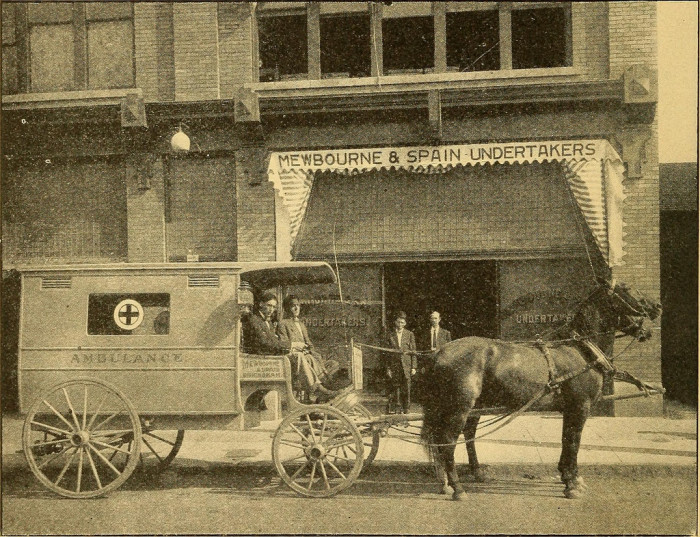 "4. This historic photo was captured in Birmingham, Alabama during the year 1909. It was used in an advertisement for a ""First-Class Ambulance Service/Funeral Director/Funeral Chapel"" business."