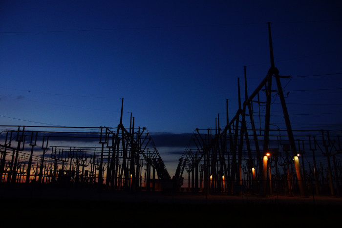 7. This is a nice picture of the American Electric Power Windmill at night. The picture is almost a little eerie.