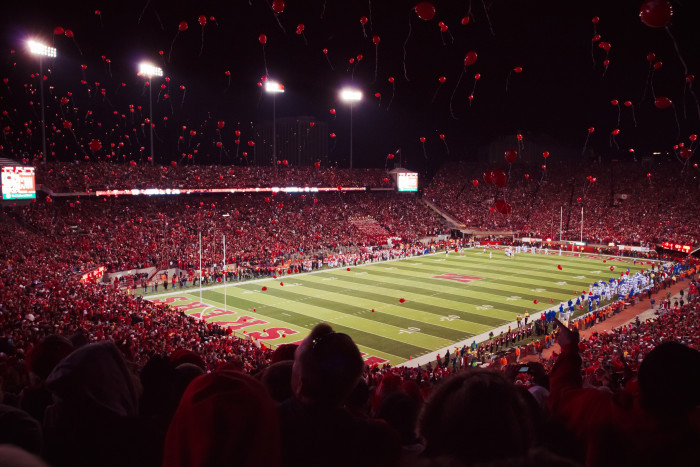 13. Memorial Stadium flitters to life with thousands of red balloons on a game night.