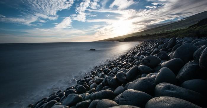 15) The rocks glisten upon the shore at Maui's Nu'u Bay.
