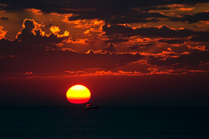 4. This is a sunset mirage on Lake Michigan. If you look close enough there is a boat that looks as if it is trying to get away from the sun.