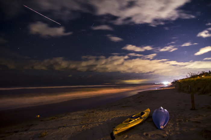 10. This is a pretty incredible picture of the Indiana Dunes. You can see shooting stars and gorgeous cloud coverage. The kayaks on the beach are nice touch.
