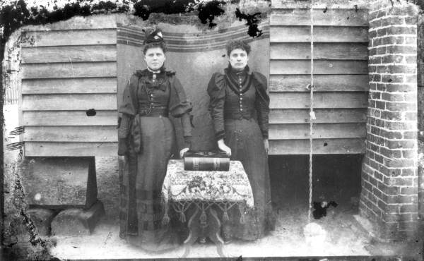 Sisters posed with a Bible, Jacksonville, 1897