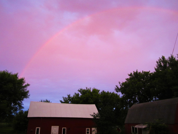 4. Another purple and pink rainbow over the MN countryside illuminates this lucky photographer's home.