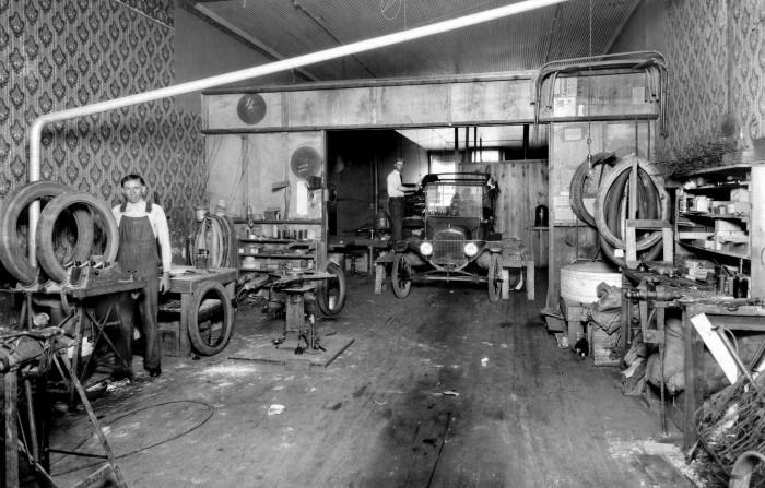 "10. ""Firestone Store, back work area, Girard, Kansas, USA, about 1920 c."""