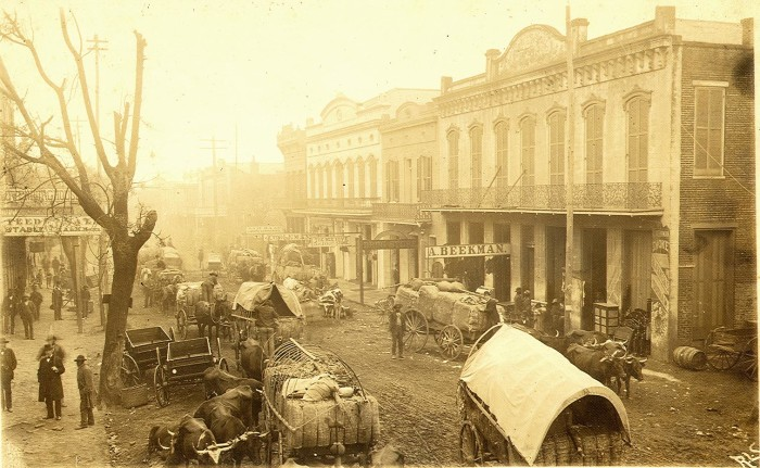 1. Even in the 1900's, the streets of Natchez were filled with the hustle and bustle of city life.