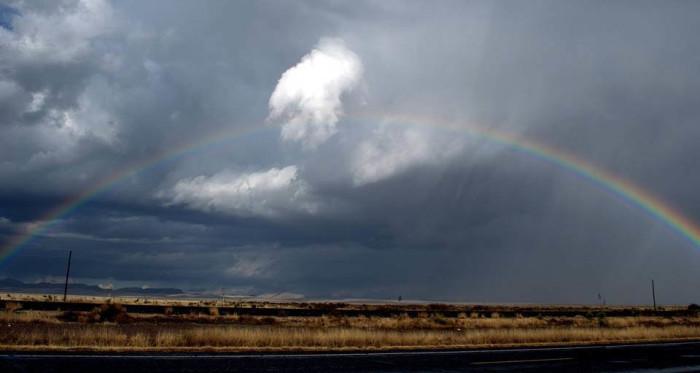 12) This lovely rainbow illuminates the dark sky just west of Marfa, TX on Highway 90.