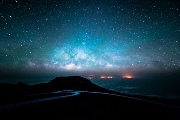 2) The Milky Way Horizon as seen from the summit of Mount Haleakala, on Maui. According to the photographer, the red fiery mass is sugar cane fields being deliberately burned near sea level.