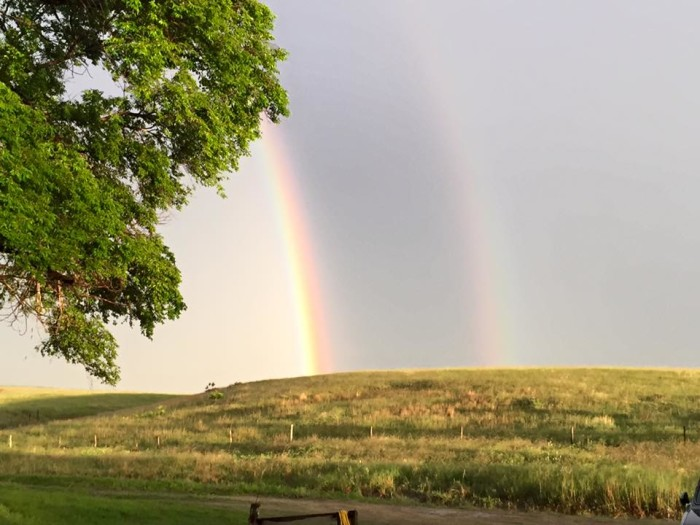 9. An ethereal double rainbow kisses the horizon in Brown County.