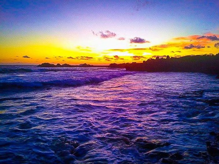 3) A beautiful sunrise captured at Marconi Point on Oahu's North Shore. The way the sun hits the water, employing a stunning hue of purple, makes this photo absolutely heavenly.