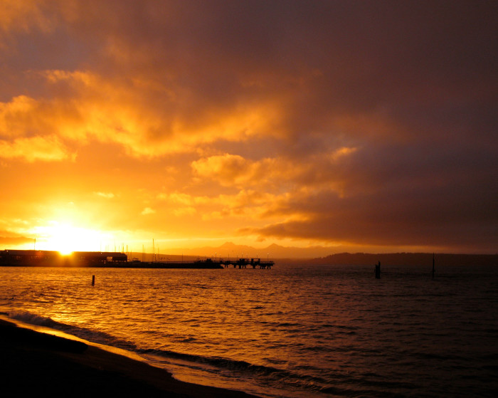12. A golden sunbreak at the Edmonds waterfront by the ferry terminal.