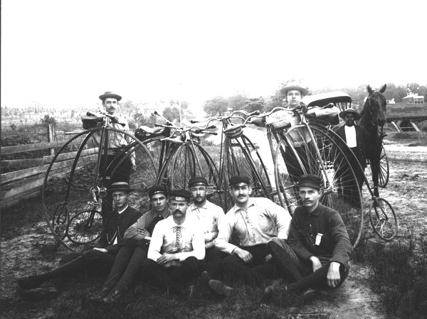 Young men with Penny-Farthing bicycles in Tallahassee, 1900