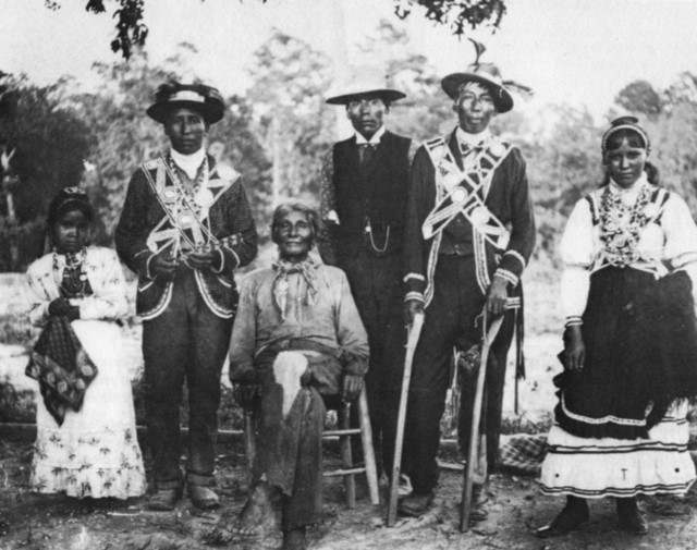 3. Taken in 1908, a group of Mississippi Choctaw Indians pose in their traditional clothing.