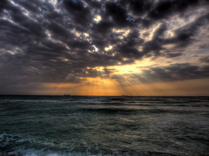 3. This shot of the sun breaking through the clouds in South Beach