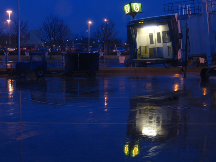 8. This is a picture in Fort Wayne at night during a rain storm. The combination of the dark blue sky and wet ground make for a pretty picture!