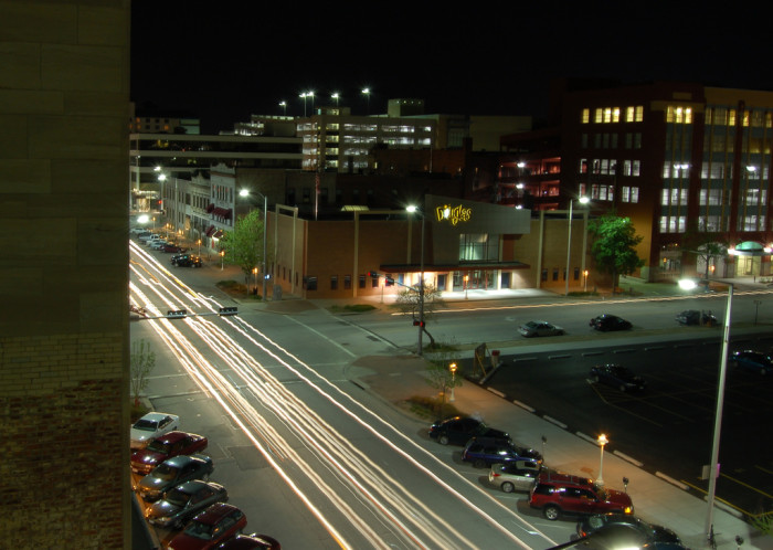 7. This peaceful Lincoln street is painted with cars' headlights in the evening.