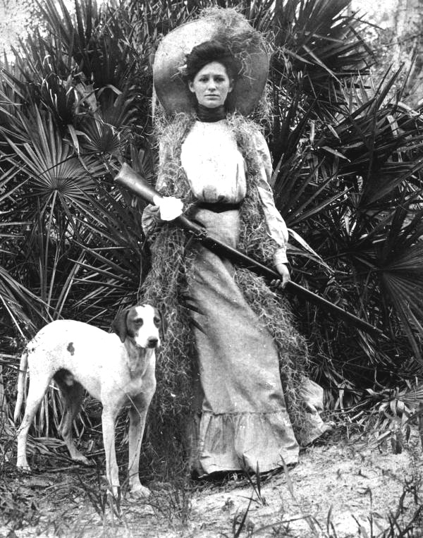 Woman with dog and rifle, 1915