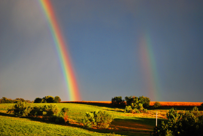 6. This double rainbow over a field is truly stunning.