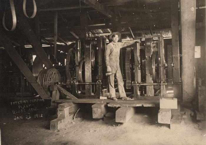 2. Here's a man working at a pumping plant at a Globe mine in January 1912.