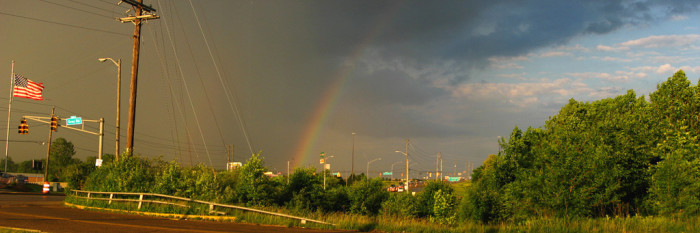 9. This rainbow was spotted 8 years ago in Greenwood. I love the way the rainbow separates the stormy sky from the clear sky.