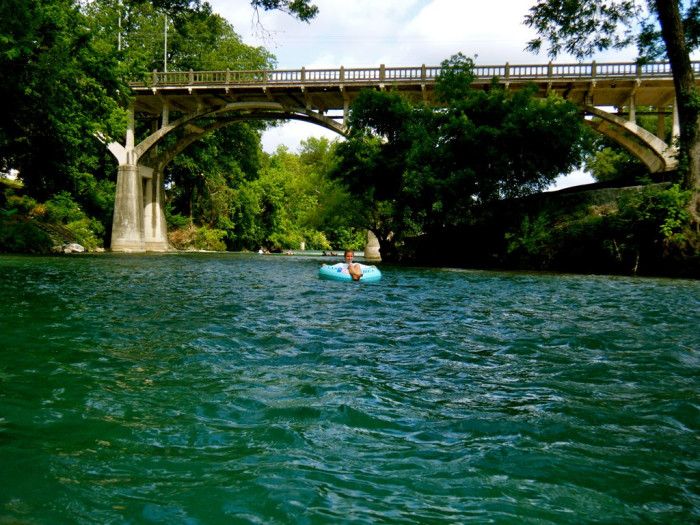 3) The calm blue-green waters of the Comal River draw quite a crowd come summertime, especially with the city tube chute!