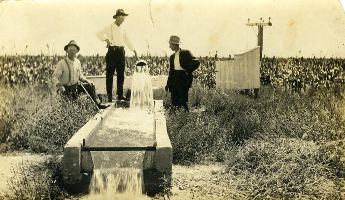 """3. """"Kansas Irrigation Pump - On verso, 'A Kansas Boy's farm. Well pumping 1300 gallons per mintue.'"""""""