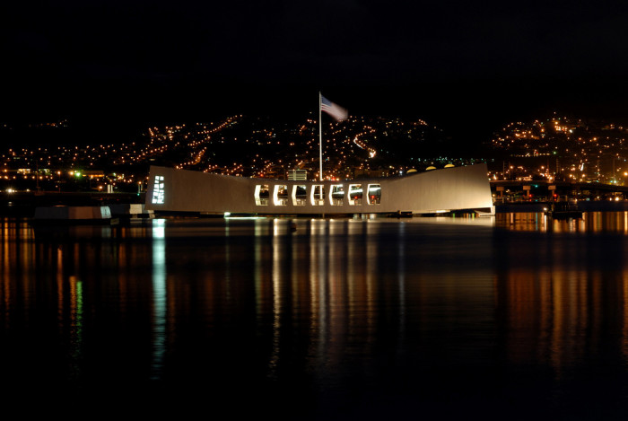 6) The USS Arizona Memorial glows in the night on the anniversary of the attacks on Pearl Harbor.