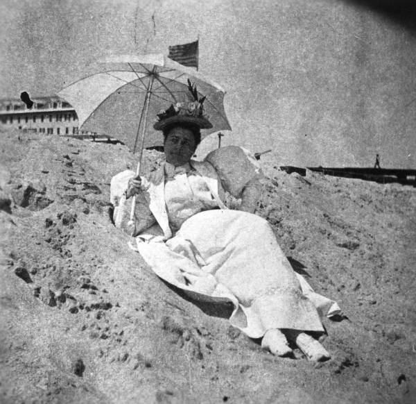 Lady in white reclining on the beach in Palm Beach, 1896