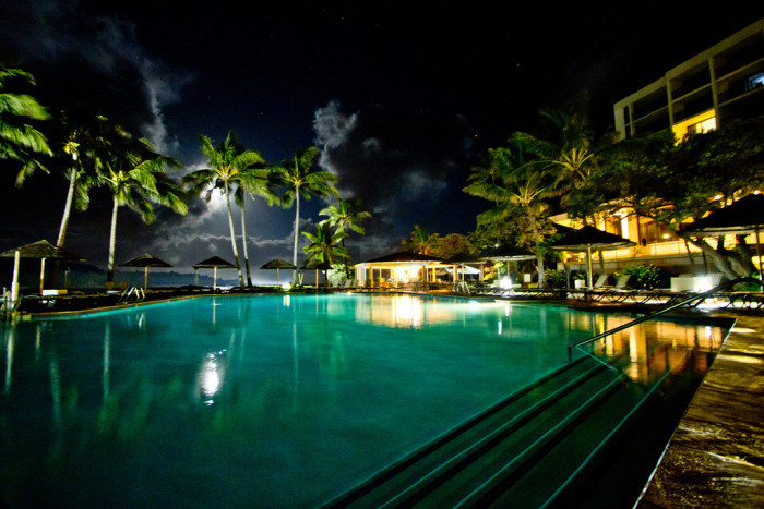 7) A beautiful blue glow from the pool – and the gorgeous moon – illuminates Oahu's famous Turtle Bay Resort at night.