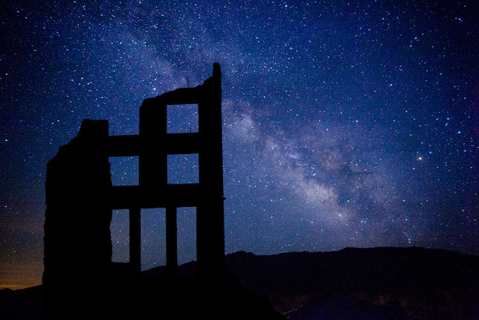 1. A composite view of the Milky Way from Stovepipe Wells Village and an abandoned building in Rhyolite, Nevada.