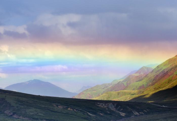 2) A wide set rainbow spanning across Denali National Park.