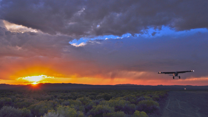2. This beautiful sunset in Austin provides the perfect backdrop while the Cessna makes its landing.