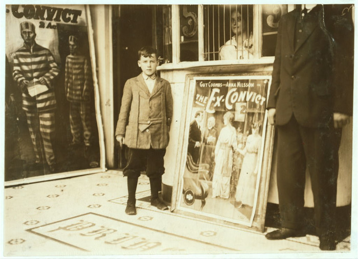 15. Brown McDowell, a 12-year-old usher at the Princess Theatre in Birmingham, Alabama, works from 10am-10pm. He can barely read and has only reached the second grade in school. This photo was taken in October 1914.