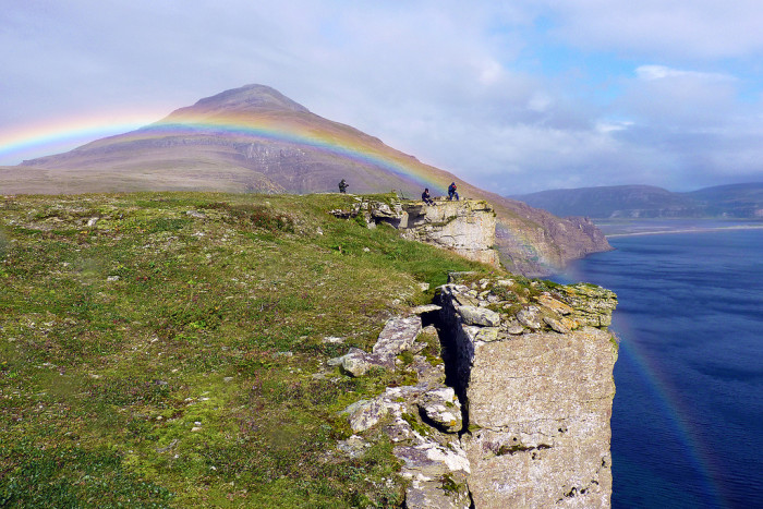 9) A rainbow jumping off the cliffs of Becharof National Wildlife Refuge!