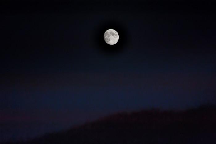 3) The full moon in a hazy sky.