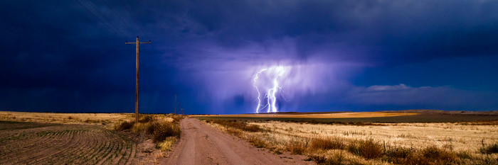 9. A nighttime storm drops triple columns of lightning in Kimball County.