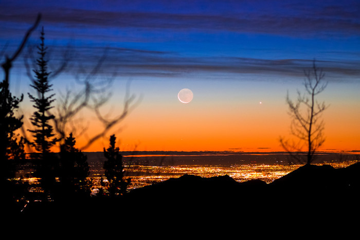 9. What it looks like to see the sun and moon come together from Indian Peaks Wilderness.