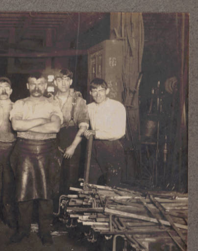 9.Eight workers at Cook Bros. Carriage Co., 1902-03.