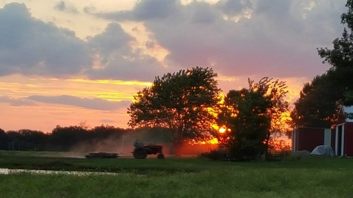 """9.  Megan Gill shared this saying, """"My dad plowing with his antique tractor as the sun sets on the farm."""""""