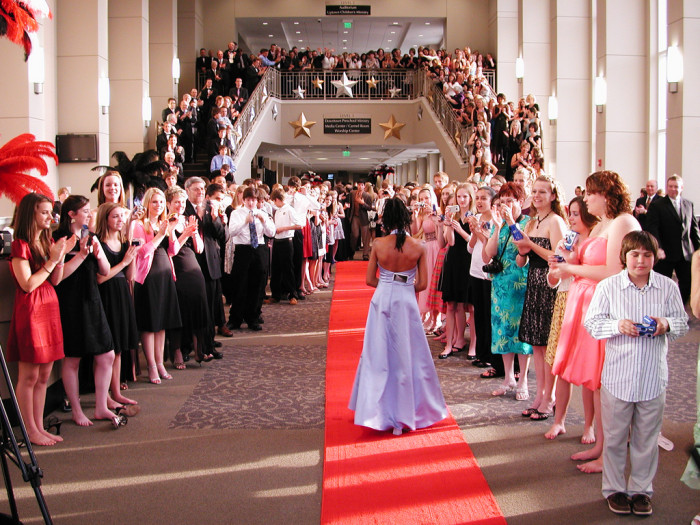 9. Your prom was a red carpet affair, and the whole town came to watch the prom walk and take pictures.