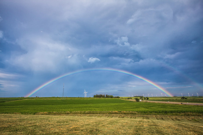 11. This perfectly arched rainbow spans a field near Walnut.