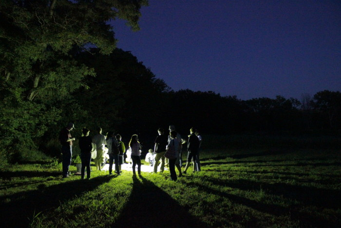 6. Adventurers gather around on Moth Night at the Spring Creek Prairie Audubon Center.