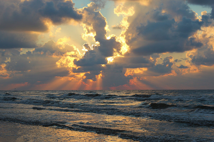 3) The ultimate relaxation...watching the sun rise over the beach. Taken by Rockin'Rita at Surfside Beach.