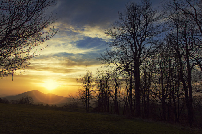 10. The sun peeks over Cahas Mountain near Boone's Mill in Franklin County.