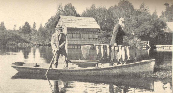 Wow. Here's an astounding image of two fishermen on Upper Klamath Lake in 1909, holding their morning catch of rainbow trout.