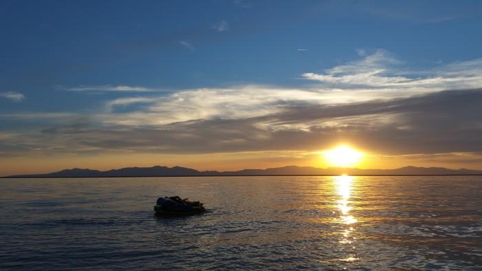 11. Gin Allred shows us the serene beauty of Willard Bay at dusk.